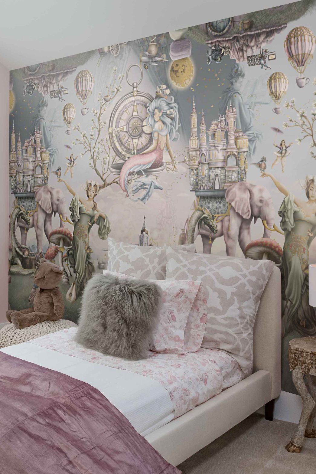 This is a Girls Fairytale bedroom wallpaper wall mural design from Australia. It features a mermaid, mother nature, bear, dragon, night, sky, elephants, castle and many more story book illustrations. The colours are pink, purple, sage green, steel blue and gold, although this is custom bespoke wallpaper so colours can be changed.