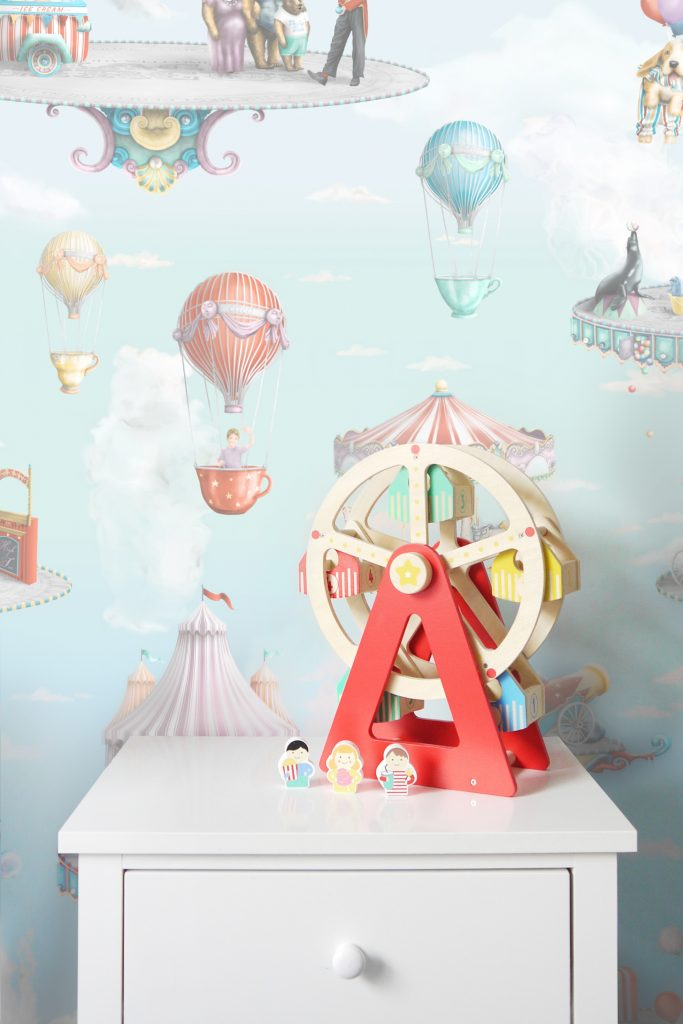 This is a kids wallaper wal mural design of a modern circus from Australia. It features a  ferris wheel, circus animals,  hot air balloons and more. Perfect for nursery or bedroom.