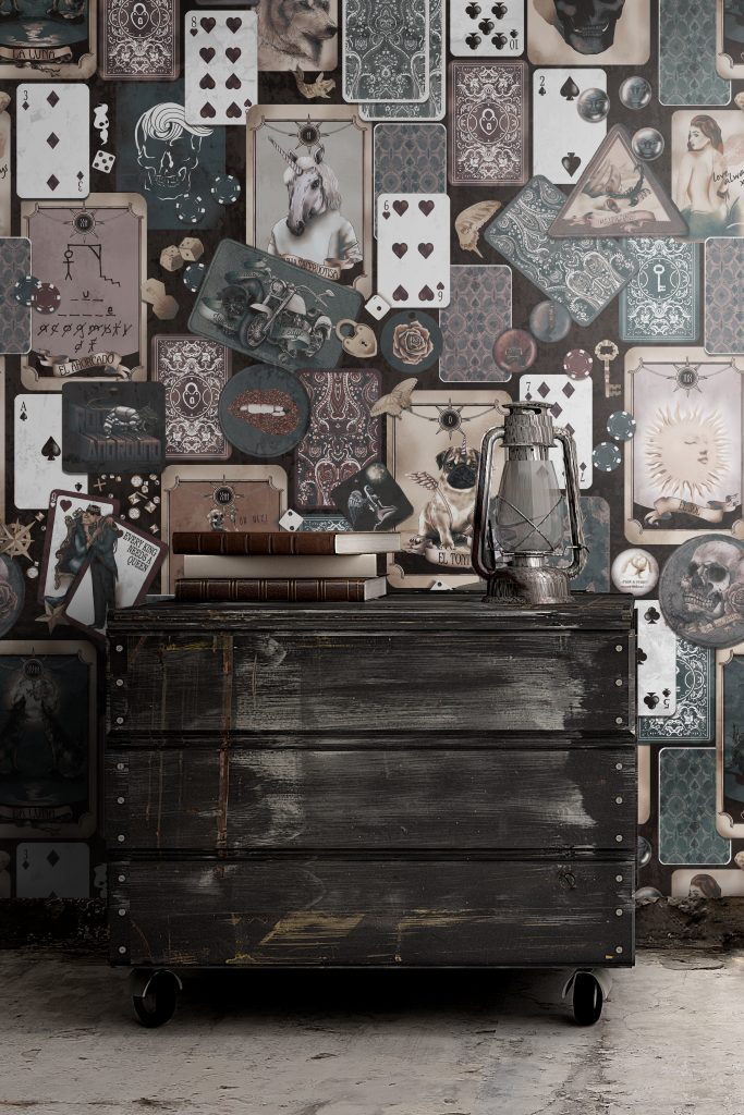 Grunge industrial wallpaper wall mural set in custom vintage colours and perfect for the industrial interior design style movement. Styled with vintage books, industrial trunk chest of drawers, old lantern.