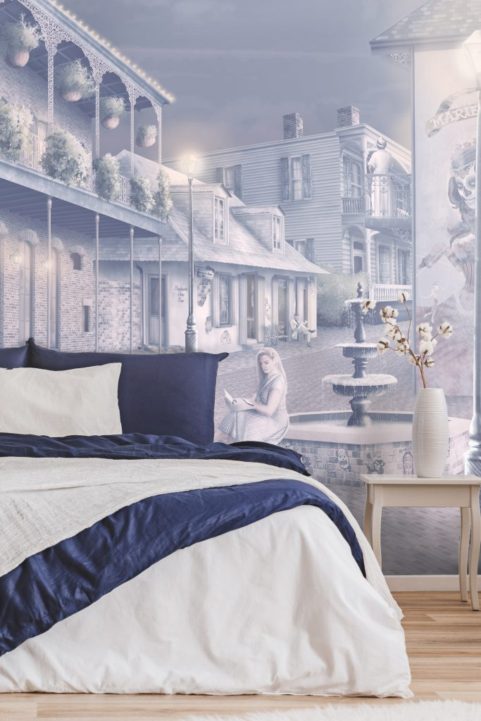New Orleans Night Interior decorating wallpaper wall mural design. In soft colours of navy blue, purple, pink and yellow. Streets of New orleans at night with fairy lights, street lamp post lights and night sky.