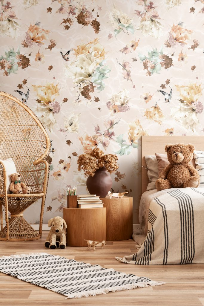 A beautiful kids bedroom with a stunning wallpaper in warm earth tone rustic colours. Features a floral and butterfly design for interior walls with a surrealist twist! Girls bedroom inspo with rattan furniture.