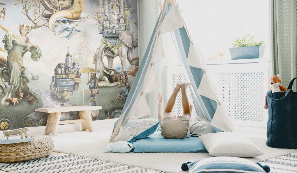An awesome boys bedroom with a forest theme. Features a magical woodland fairytale wallpaper with characters including fox, bear, deer, dragon, elephant, merman and more! Set in colours of sage green, steel blue, beige, mustard yellow, gold, grey.