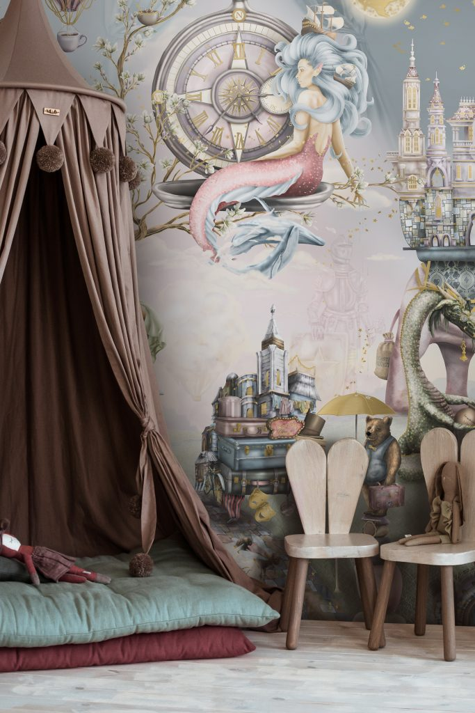 Beautiful girls bedroom design with magical fairy tale wallpaper featuring story book illustrations. Bedroom design has a stage play set up with tent canopy. In colours of pink purple gold sage green wood etc.