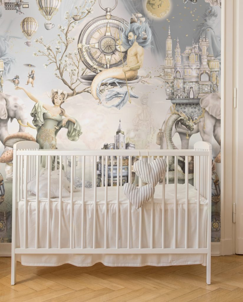 A truly stunning unisex, boys and kids wallpaper from australia. 'Whimsical Woodland - King Triton.' It is a fairy tale woodland fantasy wall mural design in vintage colours. See the stunning illustrations designed with warm tones. Printed onto vinyl wallpaper - Paste The Wall installation. Interior design of white cot with warm gold wood floor panels.